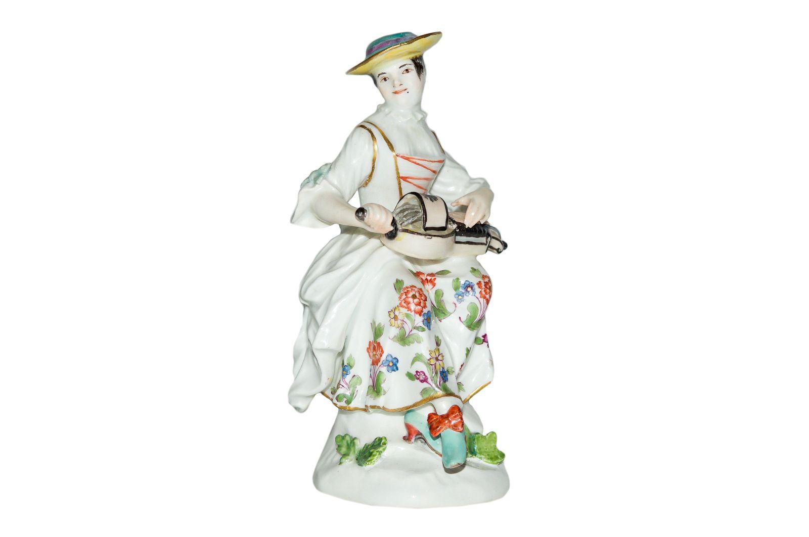 """#199 """"Tyrolean Musician"""", Meissen 1750 Model by Johann Joachim Kaendler    """"Tirolerin mit Drehleier"""" Meissen 1750, Nach einem Entwurf von Johann Joachim Kaendler Image"""