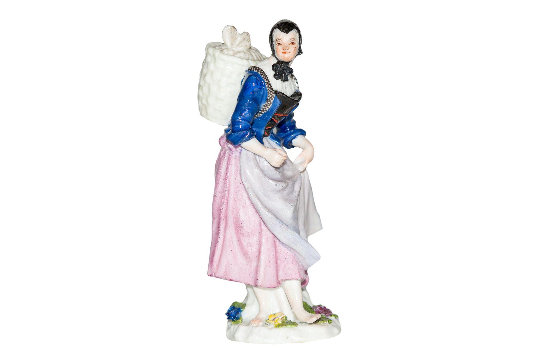 #85 A figure of a farmer`s wife, Meissen 1750   Marktfrau mit Kippe Meissen 1750 Image